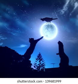 Silhouettes of animals in night sky with full moon