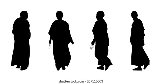 silhouettes of buddhist monks and nuns in traditional clothes walking