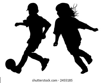 Silhouettes of children playing soccer (boy and girl)