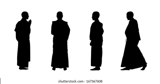 silhouettes of four buddhist monks in traditional clothes standing and walking