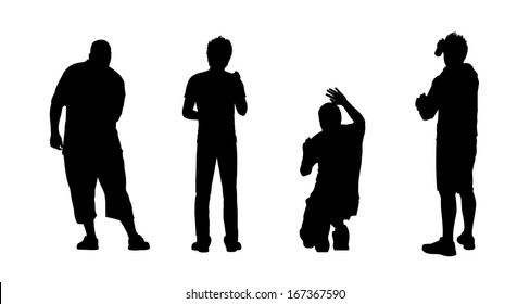 silhouettes of four young men drawing graffiti on the wall in different postures, view from behind