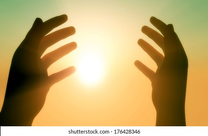 Silhouettes of hands in the sunshine.