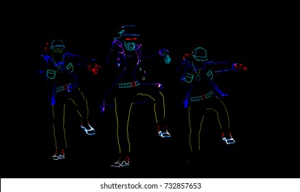 Silhouettes of people in luminous suits on a black background. Neon costume. Entertainment. 3D illutration