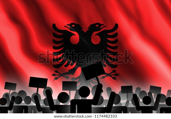 Silhouettes of people with placards on the background of the flag of Albania