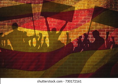 Silhouettes of protesting people against the background of the flag of Barcelona. People are on strike. Independence of the catalonia. Departure from Spain. A crisis. Barcelona, Spain.