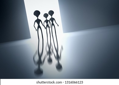 Silhouettes of spooky aliens and bright light on behind them - UFO concept