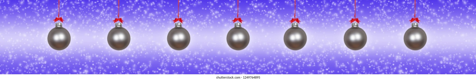 Silver christmas baubles on a violet background