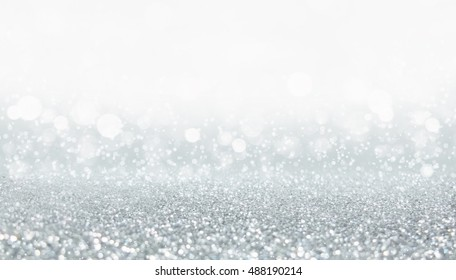 Silver christmas and bokeh lights with diamond from glitter background