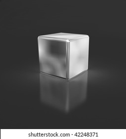 silver cube with reflection on a dark background