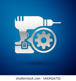Silver Drill machine and gear icon isolated on blue background. Adjusting app, service concept, setting options, maintenance, repair, fixing