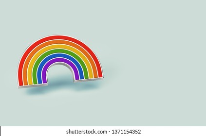 Silver gay pride rainbow pin isolated on pastel green background. Copy space on the right side. LGBTQ and homosexual minority pride symbol concept. 3D rendering