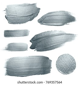 Silver glitter paint brush strokes and circle stains set or abstract dab smear texture on white background. Isolated glittering silver paint splash stain for luxury greeting card design template