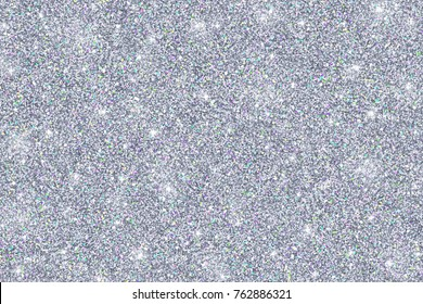 Silver glitter texture with colored particles , abstract silver background