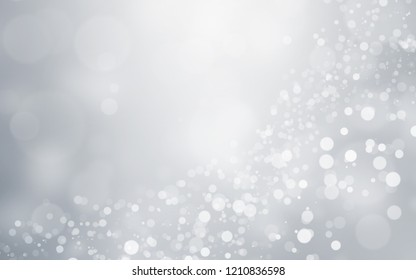 Silver light background with blur bokeh. beautiful christmas backdrop. festive defocused. cosmetic advertising design