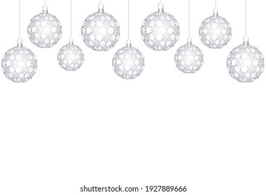 silver openwork Christmas balls on a white background