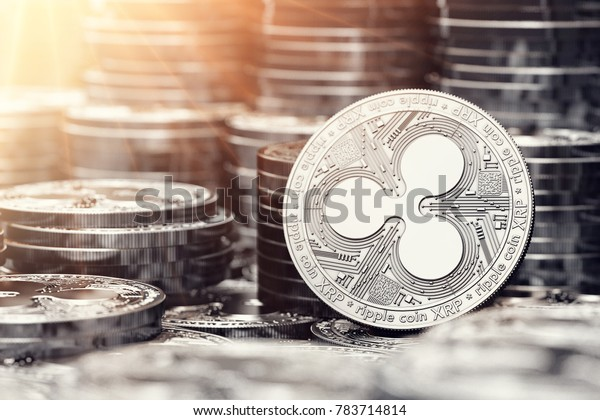 Silver Ripple coin among stack and piles of silver coins. Copy space on the left. 3D rendering