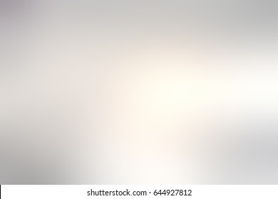 Silvery glow blurred background. Pearl grey abstraction. Silvery mist texture. Pearl shiny empty backdrop. Grey silky festive background.