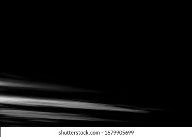 simple abstract monochrome image of white  streaks on black