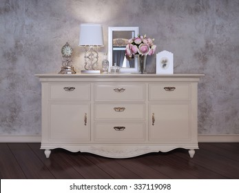 Single dresser near wall in bedroom. An elegant dresser with silver handles. Table clock, a vase of flowers, a mirror, a flask and a table lamp with a white shadow. 3D render