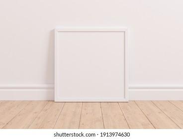 Single square  white frame mockup on white clean background on wooden floor. White frame poster on a white wallpaper. 3D Illustration.