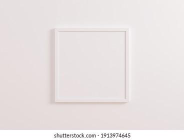 Single square white frame mockup on white clean background. White frame poster on a white wallpaper. 3D Illustration.
