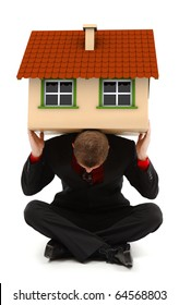 Sitting man holding a house on his back. Conceptual view of a family man, insurance or carrying alone the costs of a whole house