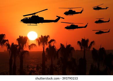 Six flying army helicopters on sunset background