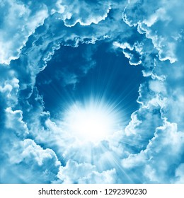 Sky with beautiful cloud and sunshine. Peaceful cloudy sky natural background. Sunny day. Divine shining heaven, light. Religion concept heavenly background