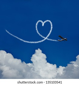 Skywriter paints a heart in the blue sky as symbol for love