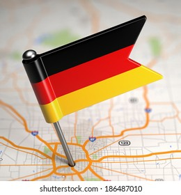 Small Flag of Federal Republic of Germany on a Map Background with Selective Focus.