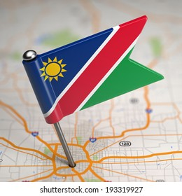 Small Flag of Namibia on a Map Background with Selective Focus.