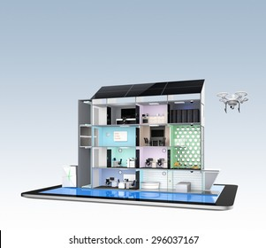 Smart office building concept model on a tablet PC. Energy support by solar panels and storage to module battery system. 3D rendering image with clipping path.