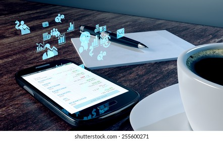 Smart phone on a office desk near coffee and notepad. Holographic stock market or business related icons floating from screen.