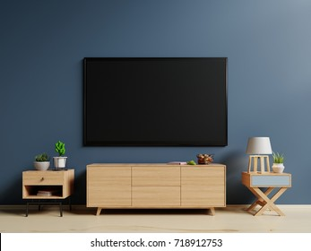 Smart TV on the blue wall in   living room,minimal design,3d rendering