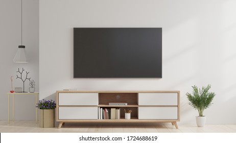 Smart TV on the white wall in living room,minimal design,3d rendering