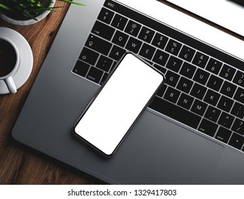 Smartphone blank screen on laptop keyboard with coffee and grass flower - 3d rendering photo realistic