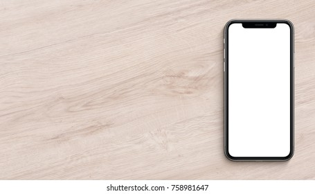 Smartphone mockup lying on wooden office desk. Banner with copy space.