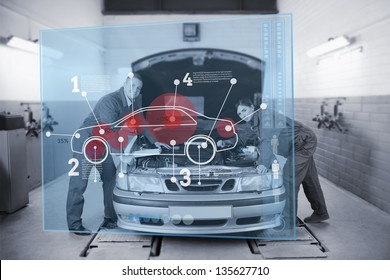 Smiling mechanics consulting futuristic interface with car diagram and statistics in black and white