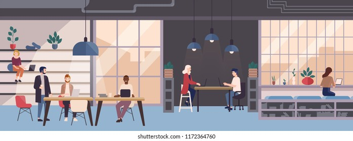 Smiling young people working on laptops in co-working area. Male and female freelance workers sitting at computers in modern open space or shared workplace. Colorful illustration in flat style.