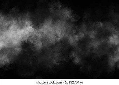 Smoke and powder overlay on black background