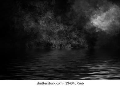 Smoke with reflection in water. Mistery fog texture background,