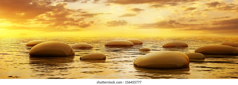 Smooth stones reflecting in water at sunset, panoramic view