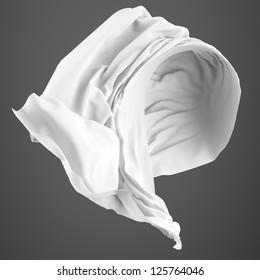 Smooth white elegant fabric isolated on gray  background