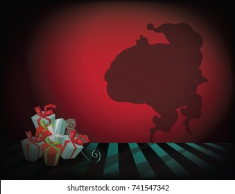 Sneaky cartoon Santa Claus shadow tiptoeing away from a stack of gifts. Background with copy space.