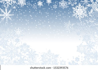 Snow and ice crystals on blue as a wintry background