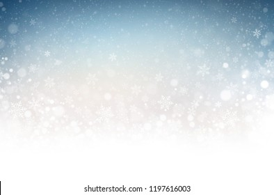 Snowflakes and snowfall on a cold blue winter background