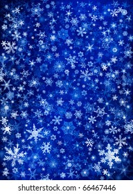 Snowflakes and stars on a blue paper background.