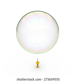 Soap bubble hovering over a yellow drawing pin on a white background