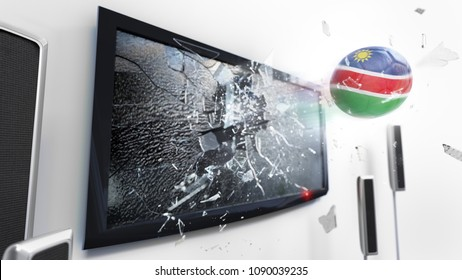 Soccer ball with the flag of Namibia flying through a shattering tv screen.(3D rendering series)