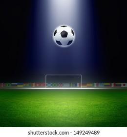 Soccer ball, green soccer stadium, arena in night illuminated bright spotlights, soccer goal